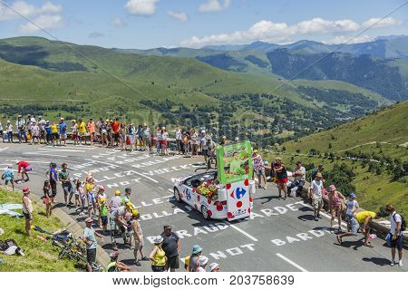 Col de PeyresourdeFrance- July 23 2014: Carrefour vehicle passing in the Publicity Caravn on the road to Col de Peyresourde in Pyrenees Mountains during the stage 17 of Le Tour de France 2014.