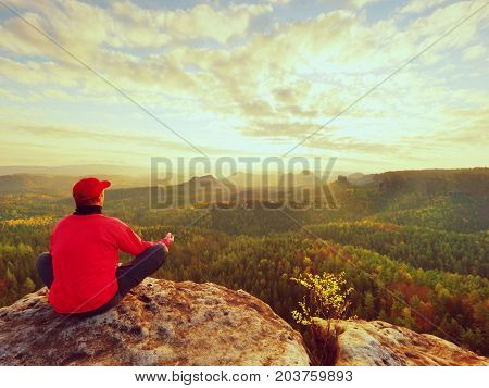 Single Man Tourist  Sit On Rock Empire. View Point With Exposed Rocky Peak Above Valley.