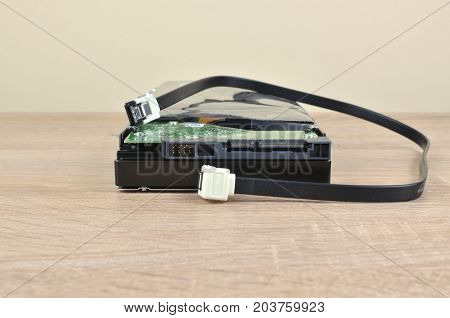 Hard Disk And Cable On A Desk