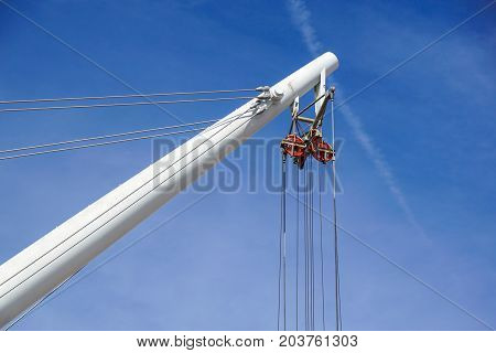 Coil for the iron cable in the tower crane against the blue sky. Mechanical component for crane operation .