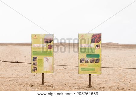 HENTIES BAY NAMIBIA - JUNE 29 2017: Information boards at the viewpoint for lichen fields in the Namib Desert between Henties Bay and Swakopmund on the Skeleton Coast of Namibia