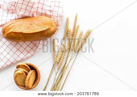 baking fresh wheaten bread on bakery work table white background top view moke up