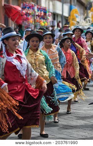 June 17 2017 Pujili Ecuador: indigenous women in traditional clothes at Corpus Christi  celebration parade