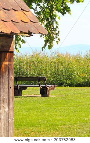old small cabin and seat on a summer meadow
