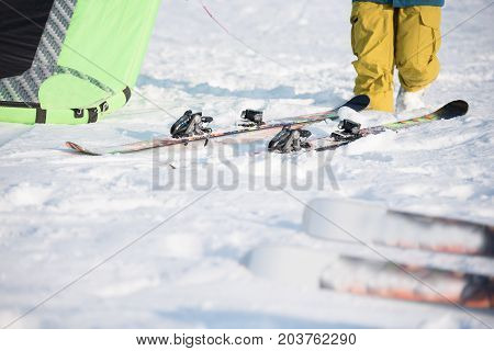 anonymous sportsmen is near skiing and parachute for Snowkiting