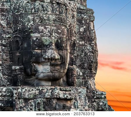 Stone smiling face buddhist in Prasat Bayon part of Angkor Khmer temple complex Cambodia