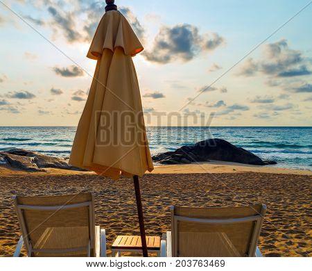 Pair of sun loungers and a beach umbrella - summer nature landscape