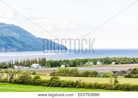 Aerial Cityscape Landscape View Of Farmland In Ile D'orleans, Quebec, Canada With Saint Lawrence Riv