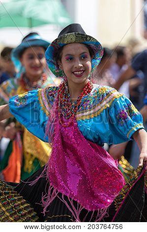 June 17 2017 Pujili Ecuador: female dancer in traditional clothing in motion at the Corpus Christi annual parade