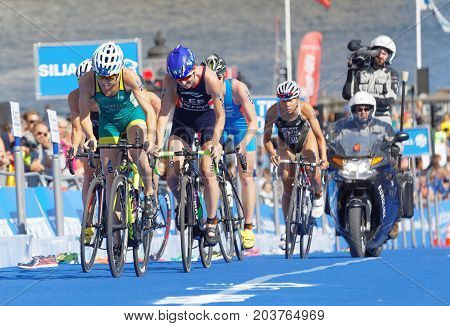 STOCKHOLM - AUG 26 2017: Group of fighting female triathlete cyclists Lee Gentle Miller and Sato in the Women's ITU World Triathlon series event August 26 2017 in Stockholm Sweden