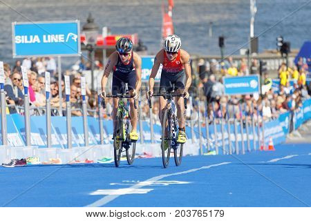 STOCKHOLM - AUG 26 2017: Leading duo female triathlete cyclist Flora Duffy and Jessica Learmonth in the Women's ITU World Triathlon series event August 26 2017 in Stockholm Sweden