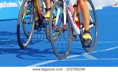 STOCKHOLM - AUG 26 2017: LColorful cycle wheels feet and legs in the Women's ITU World Triathlon series event August 26 2017 in Stockholm Sweden