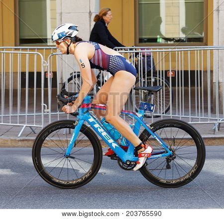 STOCKHOLM - AUG 26 2017: Side view of cycling female triathlete Kirsten Kasper (USA) in the Women's ITU World Triathlon series event August 26 2017 in Stockholm Sweden
