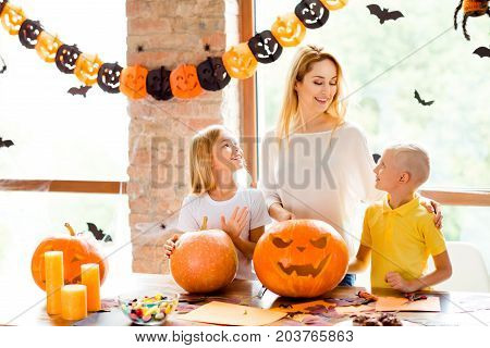 Ecxited Mommy With Two Small Blond Adorable Kids Is Prepared Jackolantern At Decorated Nice Loft Roo