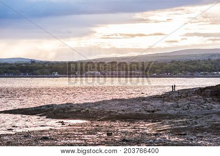 Landscape View Of Ile D'orleans, Quebec, Canada Beach With Couple During Sunset With Sun Rays, Large