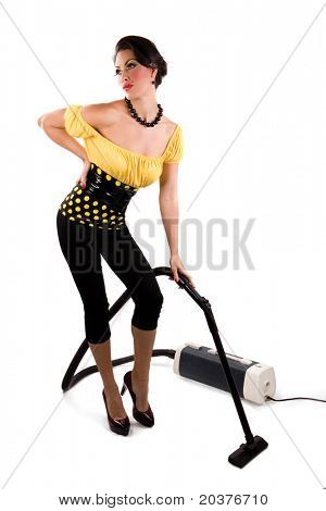 housewife in pin up style, hoovering the room