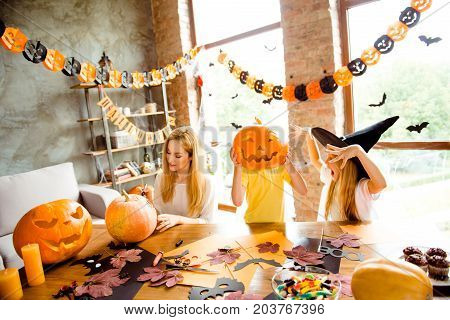 Boo! Blond Mum With Two Small Kids Siblings, Dressed In Scary Costumes, Frightening Each Other, In D