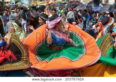 June 17 2017 Pujili Ecuador: female dancer group in traditional clothing in motion at the Corpus Christi annual parade