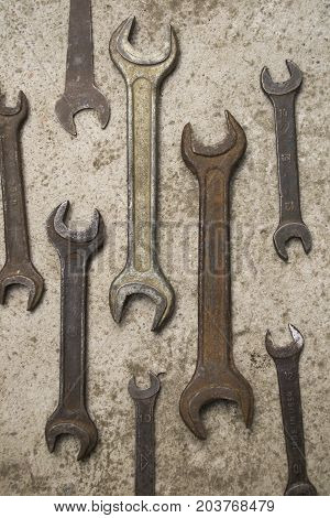 rusty spanners on a gray background,spanners, wrench