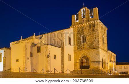 Se cathedral of Faro Igreja de Santa Maria after sunset. Dark blue sky after sundown. The capital of Algarve Portugal