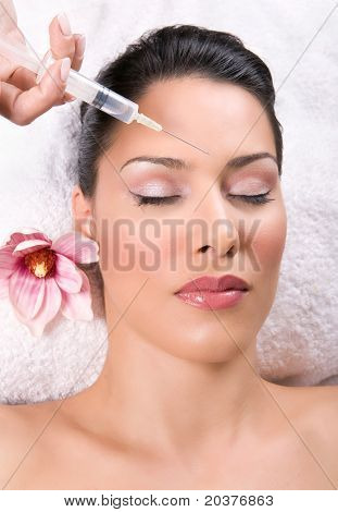 beauty treatment with silicone injection