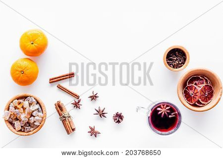 Merry christmas in winter evening with warm drink. Hot mulled wine or grog with fruits and spices on white desk background top view mockup