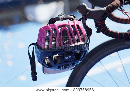 STOCKHOLM - AUG 26 2017: Closeup of a triathlon cycle helmet hanging on the handlebars in the Women's ITU World Triathlon series event August 26 2017 in Stockholm Sweden