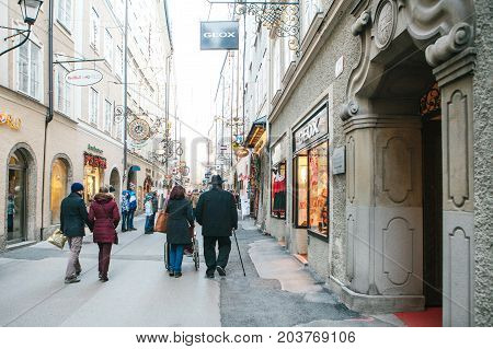 Austria, Salzburg, January 1, 2017: Getreidegasse street. A picturesque street on the territory of the old city, long considered to be the center of trade of Salzburg. Christmas holidays.