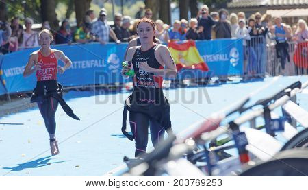 STOCKHOLM - AUG 26 2017: Triathlete Flora Duffy (BER) and Lucy Hall (GBR) change clothes in the transition zone in the Women's ITU World Triathlon series event August 26 2017 in Stockholm Sweden