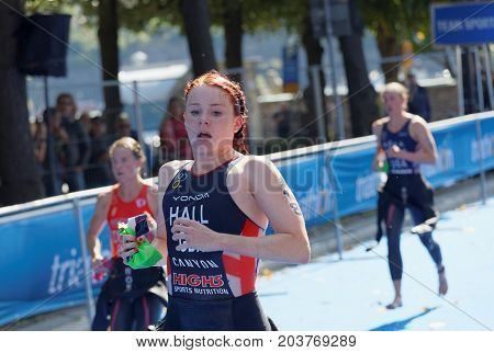 STOCKHOLM - AUG 26 2017: Triathlete Lucy Hall (GBR) and competitors running in the transition zone in the Women's ITU World Triathlon series event August 26 2017 in Stockholm Sweden