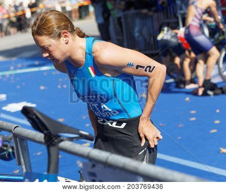 STOCKHOLM - AUG 26 2017: Triathlete Alice Betto (ITA) change clothes in the transition zone in the Women's ITU World Triathlon series event August 26 2017 in Stockholm Sweden