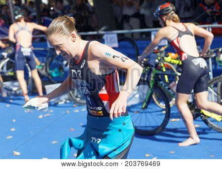 STOCKHOLM - AUG 26 2017: Triathlete Jodie Stimpson (GBR) change clothes in the transition zone in the Women's ITU World Triathlon series event August 26 2017 in Stockholm Sweden