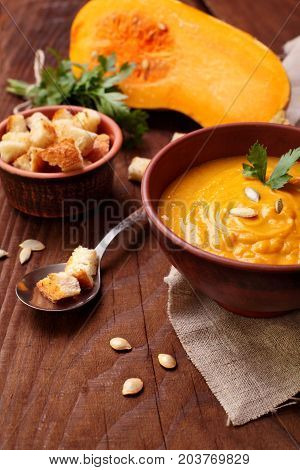 Pumpkin Cream Soup On Wooden Table .homemade Autumn Butternut Squash Soup With Croutons.autumn Dish