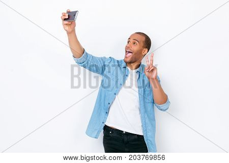 Very Excited Young African Hipster In Casual Jeans Wear Is Making Selfie Shot On Camera Of His Pda,