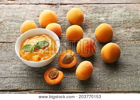 Apricot Jam In Bowl With Mint Leaf On Grey Wooden Table