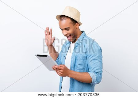 Hey There! Young Cheerful Afro American Guy Is Waving In Camera While Having Video Call From Holiday