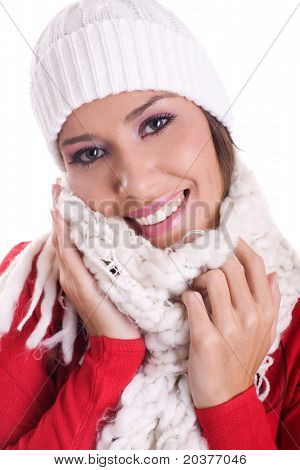 happy woman wearing woolen scarf and hat in winter