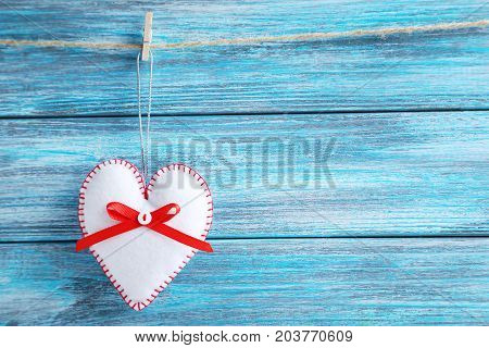Christmas Decoration Hanging On Rope On Wooden Background