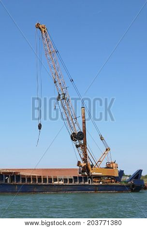 Huge Cranes At A Shipyard For The Construction Of A Dam On The S