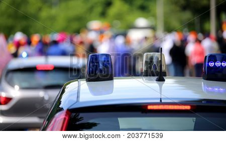 Police Cars Flashing Sirens In The City