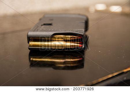 clip of ammunition. cartridges in holder close up capture.