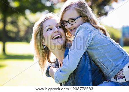 Causal Mother And Daughter In The Park