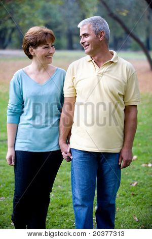 senior happy couple walking at the park