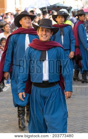 June 17 2017 Pujili Ecuador: male dancer group in traditional clothing at the Corpus Christi annual parade