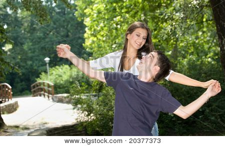teenage couple having fun at the park