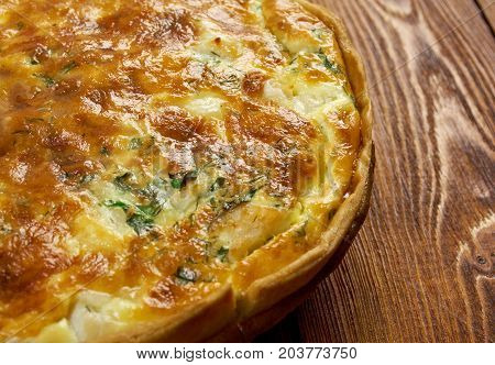 tasty homemade quiche with halibut.farm-style , close up meal