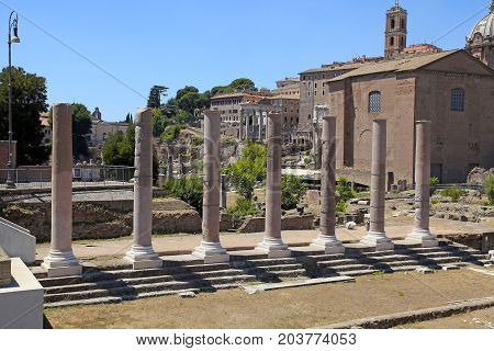 View on antique ruin forum columns on famous ancient Roman Forum, Rome, Italy.