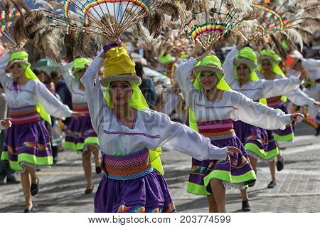 June 17 2017 Pujili Ecuador: group of female dancers with colorful traditional clothing at the Corpus Christi annual parade