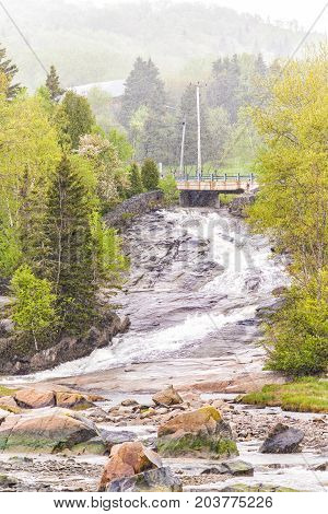 Inland Creek, River Flowing Down Rocky Cliff In Port-au-persil, Quebec, Canada In Charlevoix Region