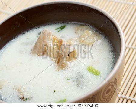 New England clam chowder with halibut , close up meal